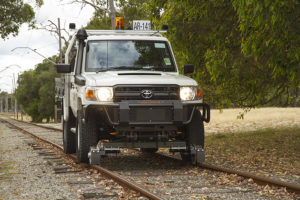 Toyota Land Cruiser with Aries Hyrail road-rail vehicle conversion for standard gauge rail