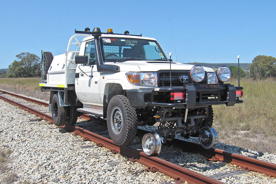 Toyota Land Cruiser with Aries Hyrail road-rail vehicle conversion for narrow gauge rail